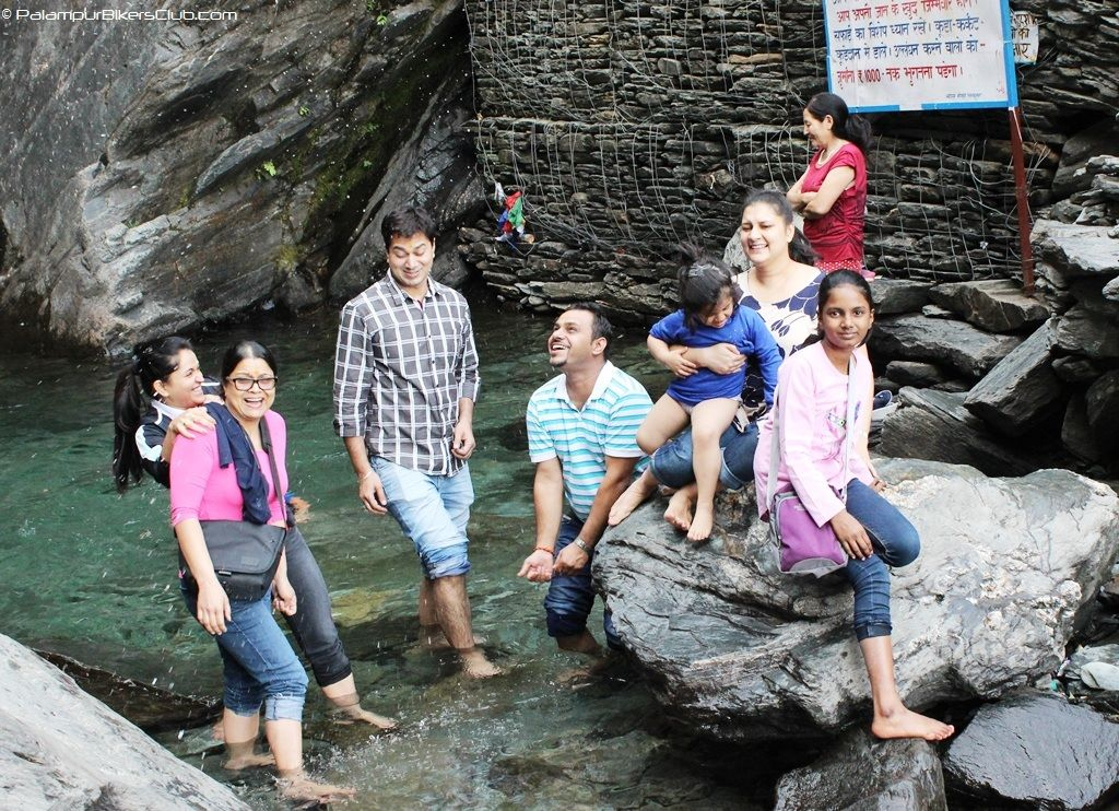 Playing with water at Bhagsu Nag Water Fall